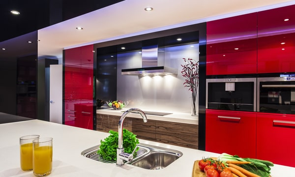 Ultra modern kitchen with red cabinets and spot lighting