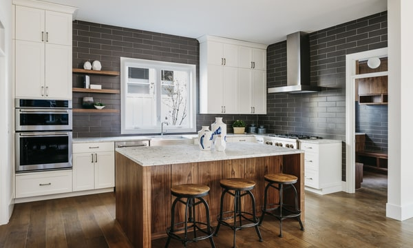 modern design contemporary kitchen with grey wall tiles, white cabinets and drak wooden flooring
